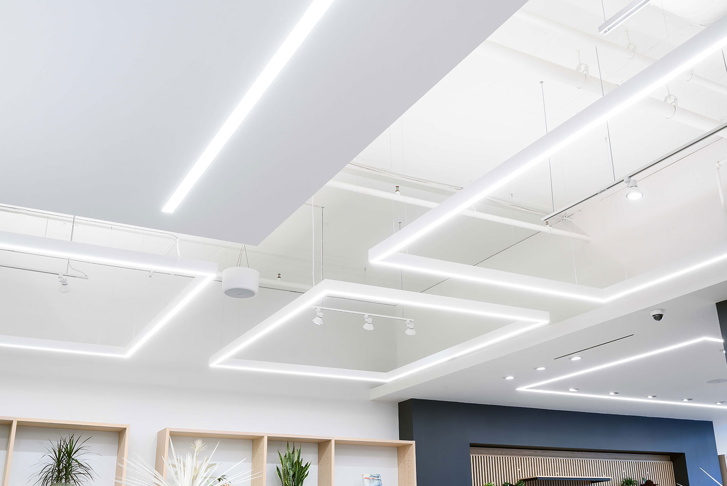 The innovative ceiling light fixtures provide soft illumination at J Crew's newly designed store